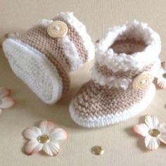 A selection of easy baby booties knitting patterns to make as gifts for a new baby or even a large doll.