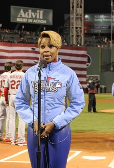 """Mary J. Blige focuses on delivering a soaring performance of """"The Star-Spangled Banner"""" prior to game one of the World Series between the St. Louis Cardinals and Boston Red Sox on Oct. 23 in Boston"""