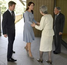 Royal encounter: They shook hands outside of the Imperial Palace...