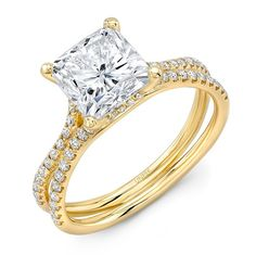 Here's a truly lovely setting from Uneek's Silhouette Collection tailored to hold a 3 ct. cushion cut diamond: this 14k yellow gold ring features a fresh and original double split shank encrusted with 68 diamond accents of .40 cwt., a perfect company for your special diamond. Classy, elegant and charming, wouldn't you agree? www.diamonds.pro