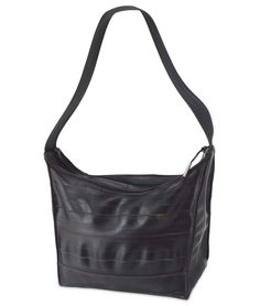 Made of recycled bike tubes. I like my bags to be light and durable. This has treated me well.