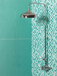 Mississippi glass tiles with Caribbean mosaics are the perfect shades for a bathroom. By Original Style.