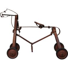 Iron Horse on Wheels  American  early 20th century  Striking and whimsical figural folk art horse, for a child to ride on. The horse would move forward as the child, feet in stirrups, bounces on it and the center spring responds. Hand made by a welder
