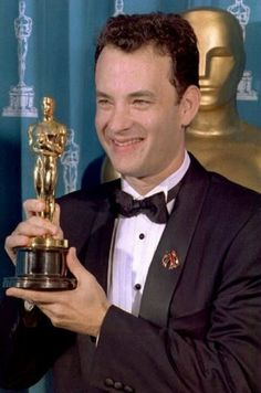 "1994: Actor Tom Hanks poses with his Oscar during the 66th annual Academy Awards ceremony after winning the award for best actor for his performance in the movie ""Philadelphia."" Photo: Getty Images"