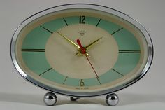 This cute vintage atomic alarm clock could get me up on time in the mornings!