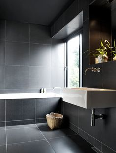 minimalistic bathroom design with black tiles in the walls and surrounding the bathtub luxurybathrooms - Design Bathroom Ideas
