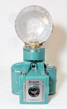 Beacon Two-twenty five (with flash) c. 1950-58. 6x6cm on 620 film. Colored model (aqua). Whitehouse products.