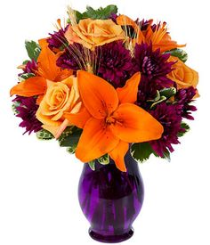 Orange Roses, Burgundy/Purple Cushion Poms and Orange Asiatic lilies in a purple vase. Send orange flowers this Fall as a special gift. Flowers For You, Fall Flowers, Orange Flowers, Fall Bouquets, Fall Wedding Bouquets, Plum Wedding, Sunset Wedding, Fall Floral Arrangements, Wedding Flower Arrangements
