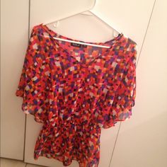 Top It's a fun top that's pretty sheer and it has elastic around the waist Allen B. Tops