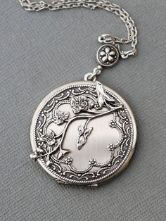 Measurements: Vintage style silver plated locket, lovely filigree design.Approximately 1-1/2 diameter.   ............................................... Locket is 1 1/2  long.  Chain is 18 inches long.  -----------------------------------------------   All of items made by myself :