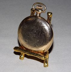 """Church Engraving on a Vintage Goldtone Waltham Pocket Watch, Case by the Illinois Watch Case Co., Elgin, Illinois, """"The Winner"""" Case Guaranteed for 20 Years."""