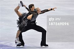 TOKYO, JAPAN - NOVEMBER 10: Piper Gilles and Paul Poirier of Canada compete in the ICE Dance free program during day three of ISU Grand Prix of Figure Skating 2013/2014 NHK Trophy at Yoyogi National Gymnasium on November 10, 2013 in Tokyo, Japan. (Photo by Koki Nagahama/Getty Images
