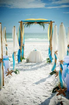 A Teal, Aqua and starfish beach Wedding with outstanding, bright and elegant!  Love the colors, fresh and rousing with this wedding decor! We've got free weddings, and group benefits, they're out there, call us to get them for you! concierge destination wedding planning 888-696-4202 #allweddingsallowed #allbridesallowed