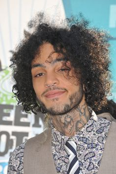 Travis McCoy is well known as the MC for the band Gym Class Heroes. He was born to a Haitian father and a mother of Irish and Native American descent.