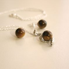 New to MillingtonsGifts on Etsy: Handcrafted Tigers Eye earrings and Necklace Sterling Silver 925 - Gift Boxed (14.95 GBP)