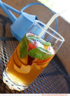 A refreshing sweet non-alcoholic #summer #drink made with green #tea, peaches, & mint leaves..