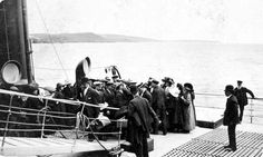 Before passengers could board a ship, like the Titanic, they had to be checked for contagious diseases.  If a doctor found anything suspicious, the passenger was not allowed to get on the ship.  One way of detecting a potential problem was to examine a person's eyes.  In this photo, we see that event taking place before individuals were allowed to board the Titanic.