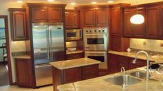 Bridgewood Cabinets offers a 100% fully custom cabinet line, but also offer the Advantage series...perhaps the best value in mid priced cabinets. So what's the difference?? Kitchen Kit, Kitchen Pantry Cabinets, Ranch Kitchen, Kitchen Ideas, Kitchen Reno, Slate Appliances, Counter Depth Refrigerator, Cabin Kitchens, Custom Cabinets