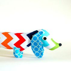 $28 Rainbow Chevron Dachshund Plush Toy.   This is Duke the friendly and fabulous stuffed Dachshund who can be an excellent bedtime companion, bright decor piece for a kids room or nursery, and make a wonderful gift for folks of all ages.
