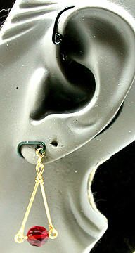 I dont know about this as an ear cuff but this is a cute idea for an earring.