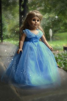 American Girl Dolls : Image : Description Designed to look like the classic blue gown from Disneys Cinderella, your Cinderella will float away among the sparkling feather weight layers