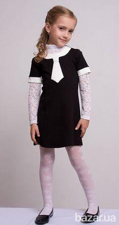 Шкільне плаття чорного кольору від українського дизайнера Sofia Shelest. Можна носити як в теплу пору року, так і в холодну, вдягаючи під низ...