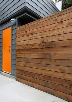 , Modern Exterior Design With Adorable Bright Orange Front Door Colors Also Dark Gray Wooden Wall House Color Also Untreated Wooden Wall And Unique Exterior Wall Light And Concrete Floor: Front Doors with Glass Designs and Ideas Design Exterior, Modern Exterior, Exterior Colors, Exterior Paint, Grey Exterior, Pintura Exterior, Orange Front Doors, Front Door Colors, Modern Front Door