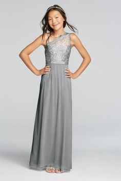 Your junior maids will adore this pretty metallic lace one shoulder dress!  Floor length mesh dress features a beautiful one shoulder metallic lace bodice with an optional spaghetti strap for extra comfort.  Attached grosgrain ribbon detail at waist.  Complements perfectly with Bridesmaid Style F17063M.  Fully lined. Imported. Back zipper. Dry clean only. To protect your dress please use our Non Woven Garnmet Bag
