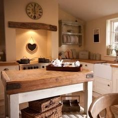 Cream painted kitchen cupboards, inglenook range cooker and pine table and chairs. Plate rack and Garden Trading Kitchen accessories. New Kitchen, Kitchen Decor, Kitchen Design, Island Kitchen, Kitchen Ideas, Cosy Kitchen, Kitchen Sink, Kitchen Window Sill, Kitchen Layout