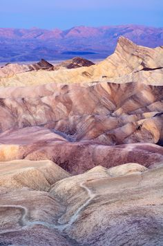 Death Valley National Park, California. Why We Love It: Located on the eastern border of California, Death Valley is America's lowest, hottest, and driest point. But that doesn't make watching the sunset from Zabriskie Point any less beautiful.