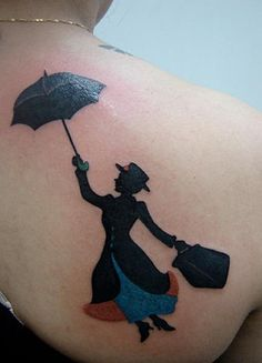 Mary Poppins tattoo.  Ok, I love Mary Poppins and this is a really good looking tattoo, but I don't think I would tattoo this on my body.