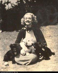 Bette Davis with two Scottish Highland Terriers and a Sealyham Terrier.