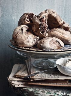 Mum's Chocolate Meringues – the key with meringues is to work fast and get them into the oven straight away. 1 teaspoon cream of tartar 1 teaspoon cornflour 1 tablespoon espresso coffee powder 1 tablespoon dutch-process cocoa powder, plus extra for dusting 100 g good-quality dark chocolate, finely chopped ½ lemon 6 free-range egg whites, at room temperature 300 g caster sugar 1 teaspoon white vinegar Whipped cream, to serve Preheat the oven to 140˚C fan -forced and line two baki