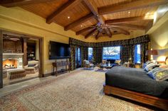 Traditional Master Bedroom with interior wallpaper, limestone tile floors, Cathedral ceiling, Carpet, Ceiling fan