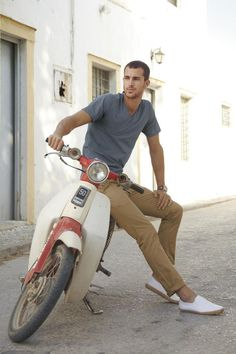 Shop this look on Lookastic:  http://lookastic.com/men/looks/grey-v-neck-t-shirt-khaki-chinos-white-espadrilles-brown-watch/11365  — Grey V-neck T-shirt  — Brown Watch  — Khaki Chinos  — White Leather Espadrilles