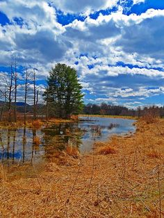 A scene in early Spring with clouds filling up the blue sky in Winchester, New Hampshire. MTBobbins Photograpy