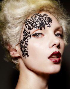 Lace face paint.  LOVE.