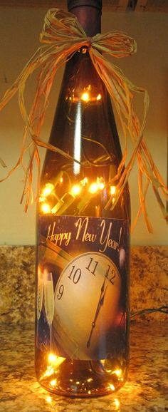 Custom label for an empty wine bottle, filled with a 50 count string of white lights.