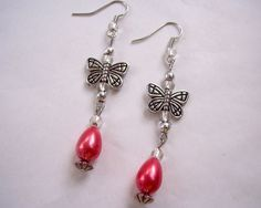 Butterfly Charm Earrings Coral and Silver by TheButterfliesGarden #handmade #earrings #jewelry #butterfly #butterflies #coral #wings #charm #silver #beaded #bugs #gifts #etsy