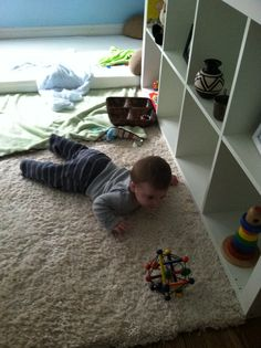 Montessori Floor Bed - Our first time with using our floor bed and we LOVE it. Instead of our son crying to get out of a crib, most mornings we just hear him playing/working with materials from his shelf. He is 6 months here.