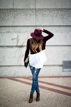 Winter outfit: burgundy cropped sweater, white blouse, distressed jeans, burgundy booties, leopard clutch, burgundy hat