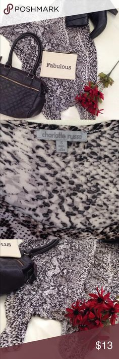 Cute snake print tunic In good used condition. Has cute tunic cut and scrunchy/loose fit. Size small but can also fit medium. Colors are dark brown and cream Charlotte Russe Tops