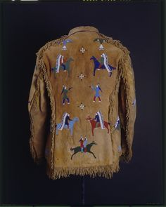 Man's coat, probably Lakota (Teton/Western Sioux) (attributed), circa 1890, Hide, glass bead/beads, sinew, cotton cloth, metal button/buttons, cotton thread, pigment/pigments. Sewn, overlay beadwork, lined, fringed