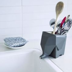 "Decorate your kitchen or bathroom with this cute Jumbo Cutlery Drainer Eliminate messy water puddles The trunk hangs over the edge and water drips directly into the sink Not recommended for dishwasher Approx. 6.29"" x 3.93"" x 4.52"" / 16 x 10 x 11.5 cm  Sometimes, a runny nose can be a big plus. Jumbo the elephant will be more than happy to drain all excess water from your wet cutlery straight into the sink. Use the Jumbo Cutlery Drainer in the bathroom to store your toothbrushes or transform…"