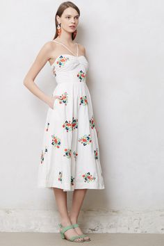 Could do with iron-on sheet and flowers cut out of fabric of old dress/skirt onto solid color skirt.  Floristitched Midi Dress - Anthropologie.com