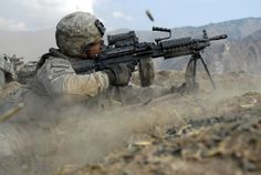U.S. Army Pvt. John Stafinski fires his M-249 squad automatic weapon during a three-hour gun battle with insurgent fighters in the Waterpur Valley, in Kunar province, Afghanistan, on Nov. 3, 2009. Stafinski is an infantryman, with Charlie Company, 2nd Battalion, 12th Infantry Regiment, 4th Infantry Division. DoD photo by Sgt. Matthew Moeller, U.S. Army. (Released) http://www.defense.gov/photos/newsphoto.aspx?newsphotoid=11914#