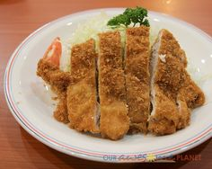 Tonkatsu Set (P190). With Japanese Rice, Miso Soup, and Japanese Pickles.  The pork cutlet had thick slices, with more meat and less crumbs. It was cooked on the spot and came with generous servings of vegetables. The meat was a bit tough though.