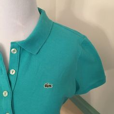 LACOSTE  top size 42 Women's small to medium fit. Polo style with 5 buttons down front. Only been worn a couple time. Dark teal green. 94 % cotton 6% elastane. Size 42 In Locoste. Lacoste Tops Button Down Shirts