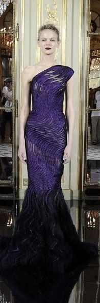 Rami Kadi. interesting form on this purple and black floor length gown