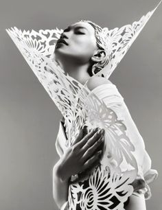 for Harper's Bazaar China  A visually striking story featuring outfits crafted solely from hand cut paper by chinese traditional paper-cutting artists